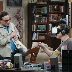 As Sheldon reaches for a butterfly, Leonard gives him a shock.