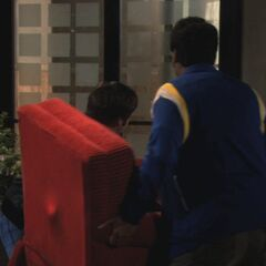 Raj and Howard bringing the chair to apartment 4A.