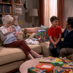 Raj's family with Claire.
