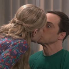 Ramona kisses Sheldon.
