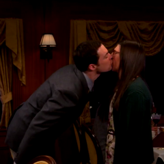Sheldon sarcastically kisses Amy.