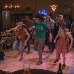 Dancing at cowboy bar.