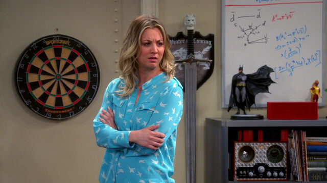 File:Penny asking about dart board.jpg