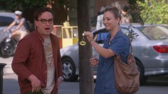 Penny dangles keychain in front of Leonard