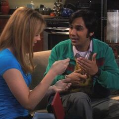 Raj gives Emily a gift.