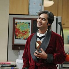 Raj in a smoking jacket.