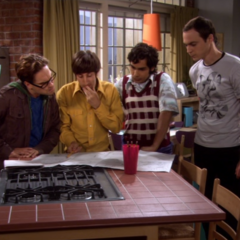 The gang deciding how best to organize Penny's apartment.