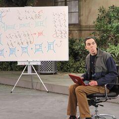 Sheldon gives Howard a raspberry.