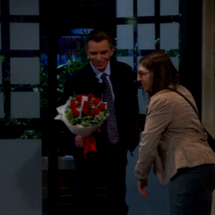 Amy admiring the doctor's bouquet of roses.