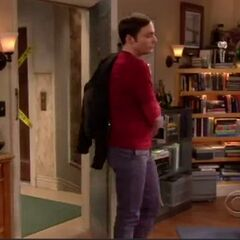 Sheldon enters the room, not caring that Penny is sitting in his spot.