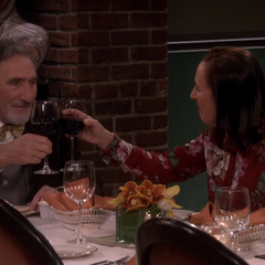 Toasting each other.