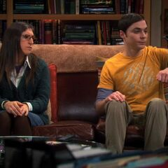 Amy looks at Sheldon, who has Lovey Dovey perched on his arm.