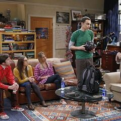 Sheldon packing his scavenger hunt backpack in apartment 4A.