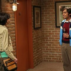 Raj talking to Lucy outside his apartment.
