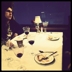 Amy dining with Sheldon.