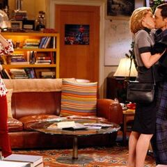 Drunk Beverly kisses Sheldon.