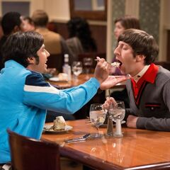 Raj giving Howard a taste of his dessert.