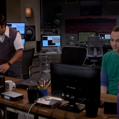 Sheldon working with Raj.