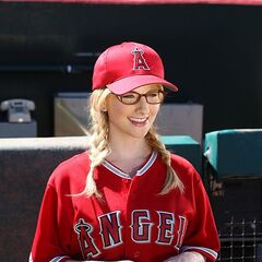 Bernadette watching Howard throw out the first pitch at an L.A. Angels game.