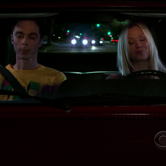 Penny driving Sheldon to his date with Amy.