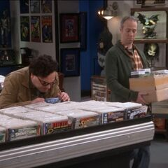 Leonard sneezes on the Batman comics.