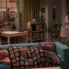 Amy finds Leonard on their couch.