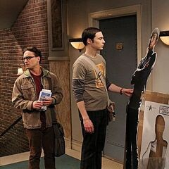 Leonard looks over at Penny's as Sheldon unpacks his life-size Spock cutout.