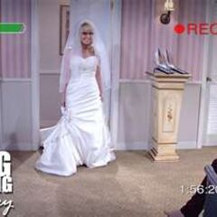 Bernadette trying out a wedding dress with Amy the maid of honor recording the session.