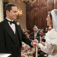 Amy slips on Sheldon's ring.
