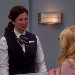 Bernadette yells at the baggage clerk. Where is her mother-in-law?