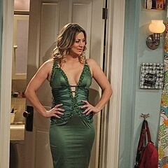 Penny in a sexy green dress.