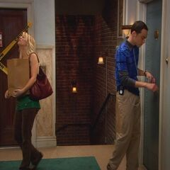 Penny and Sheldon in the hallway.