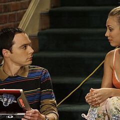Penny talking to Sheldon.