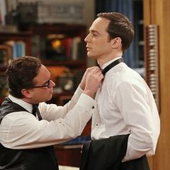 Leonard helping Sheldon with his tie.