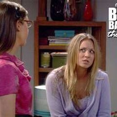 Penny looking uncomfortable after Amy tells her that she has a better shot at getting her in bed than Leonard.