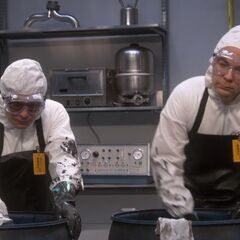Leonard and Sheldon both scrubbing out irradiated grease.