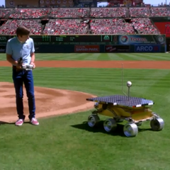 Mars rover prototype slowly delivering the first pitch at an LA Angels game.