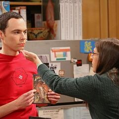 Amy closing Sheldon's mouth.