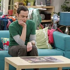 Sheldon studying the puzzle.