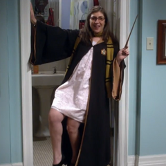 Amy dressing as a Harry Potter wizard.