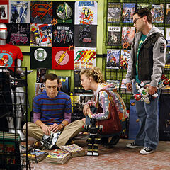 Leonard and Penny treating Sheldon like their child.