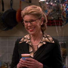 Beverly toasting Sheldon.