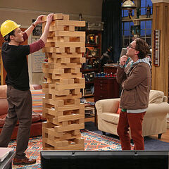 Sheldon and Leonard playing giant <i>Jenga</i>