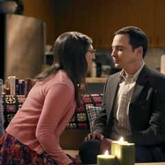 Amy leans in to kiss Sheldon.