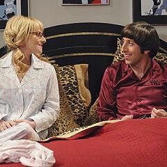 Howard and Bernadette in bed together.