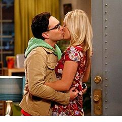 Kissing each other.