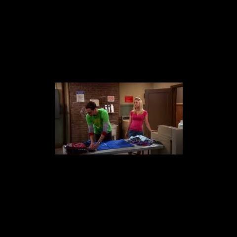 Sheldon folding his clothes.