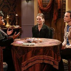 Penny drags Sheldon to a psychic.