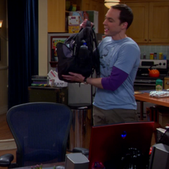 Sheldon showing his PRK or Public Restroom Kit back pack.