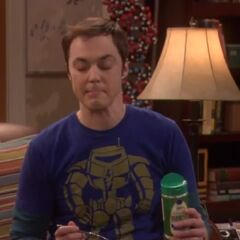 Sheldon tries to get his hair out of his eyes.